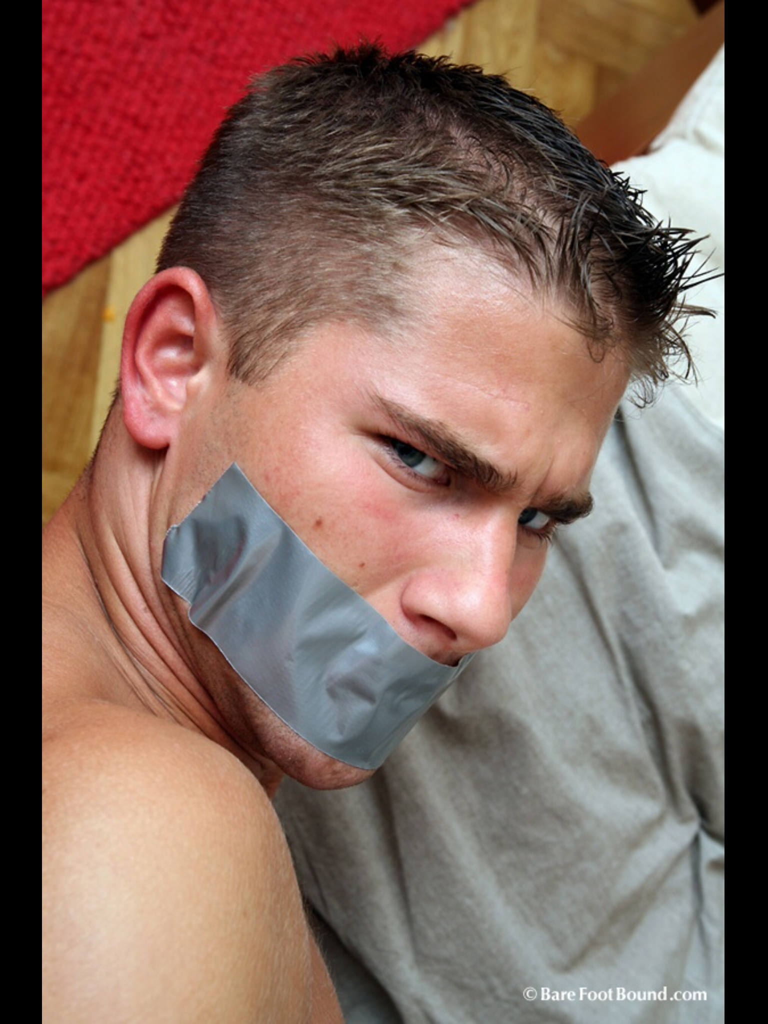Mouths gagged with duct tape