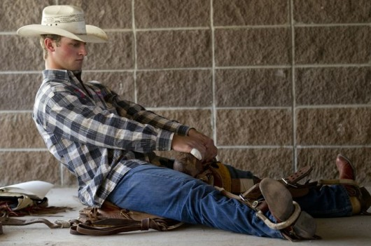 Riley Knoll from Mandan, N.D. practices a riding technique in his saddle in a ready area behind the main chutes before the Cheyenne Frontier Days rodeo on Friday, July 29, 2011, at Frontier Park.