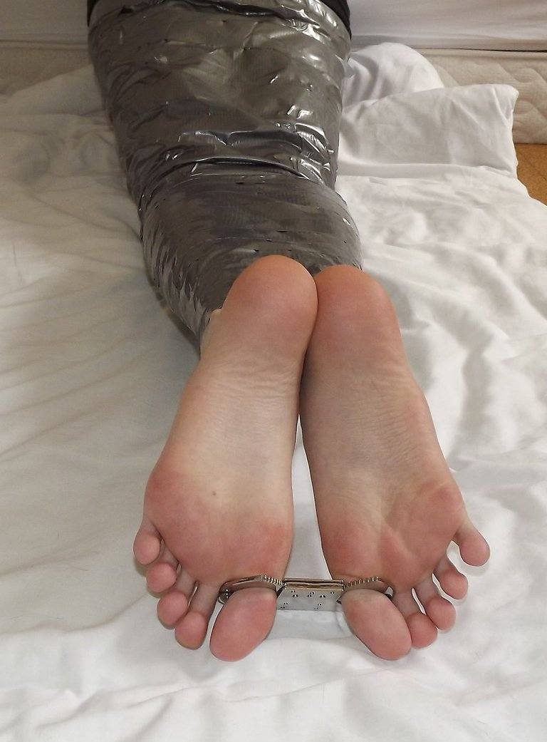 Barefoot on tip toe bondage